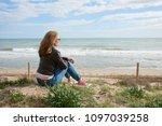 rear view shot of relaxed... | Shutterstock . vector #1097039258
