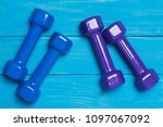 two pairs of gantelae on blue... | Shutterstock . vector #1097067092
