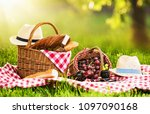 picnic on a sunny day with red... | Shutterstock . vector #1097090168