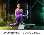 young woman in the gym with a... | Shutterstock . vector #1097125412