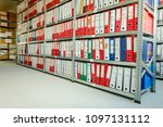 stacks of files and paperwork... | Shutterstock . vector #1097131112