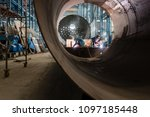 two workers welding in the... | Shutterstock . vector #1097185448
