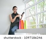 asian woman with shopping bag... | Shutterstock . vector #1097186246
