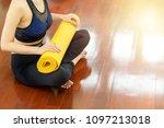 yellow yoga mat is in hands... | Shutterstock . vector #1097213018