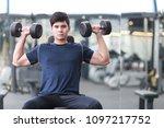 asian men are exercising ... | Shutterstock . vector #1097217752