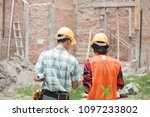 two young construction worker... | Shutterstock . vector #1097233802