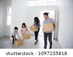 happy young asian family moving ... | Shutterstock . vector #1097235818