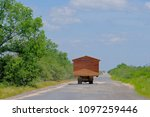 prefab house moving on a truck... | Shutterstock . vector #1097259446