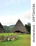 Small photo of Flores, Indonesia - January 1, 2017: Traditional Conical Hut and Compang Stone Circle, The Center of Wae Rebo Village