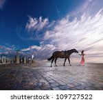 The young woman with a horse leave a city - stock photo