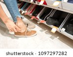 close up of woman trying on... | Shutterstock . vector #1097297282