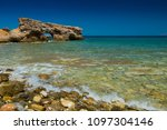 rocky coast. beach in greece.... | Shutterstock . vector #1097304146