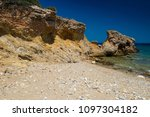 rocky coast. beach in greece.... | Shutterstock . vector #1097304182