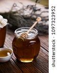 fresh honey on wooden table | Shutterstock . vector #1097323952