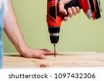 drilling in the wooden plate.... | Shutterstock . vector #1097432306