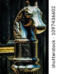 Small photo of Iron Horse Head atop a post in the French Quarter of New Orleans. Selective focus and good detail of this cast iron horse head. These are commonplace and are found on sidewalks near street curbs.