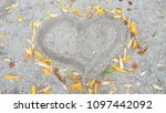 heart framed in the sand with... | Shutterstock . vector #1097442092