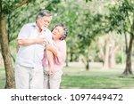 senior asian man holding his... | Shutterstock . vector #1097449472