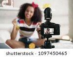happy girl at home speaking in... | Shutterstock . vector #1097450465