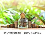 house model on coins saving for ... | Shutterstock . vector #1097463482