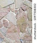 Small photo of Pattern of decorative stone wall background.Stone wall texture. random size stone wall.Background of stone wall, concrete connection.