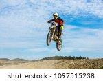 racer on a motorcycle in flight ...   Shutterstock . vector #1097515238