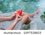 girl holds a water melon in her ... | Shutterstock . vector #1097528825