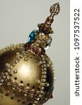 Small photo of Golden royal regalia and symbol of authority decorated with gems