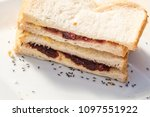 Small photo of Black ants on a white breat sandwich