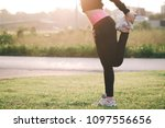 woman is stretching before...   Shutterstock . vector #1097556656