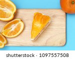piece of orange cake | Shutterstock . vector #1097557508