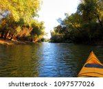 bow of yellow kayak. kayaking... | Shutterstock . vector #1097577026