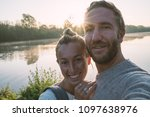 young couple taking a selfie... | Shutterstock . vector #1097638976