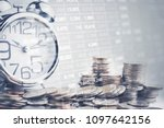stacking coins with alarm clock ...   Shutterstock . vector #1097642156