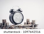 clock and rows of coins for...   Shutterstock . vector #1097642516