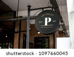 signage outside a restaurant... | Shutterstock . vector #1097660045