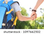 young father taking his child... | Shutterstock . vector #1097662502