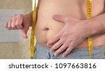 a fat man measures his waist  a ...   Shutterstock . vector #1097663816