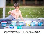 charming boy drawing on the... | Shutterstock . vector #1097696585