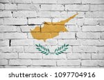 Cyprus flag is painted onto an old brick wall