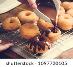 homemade chocolate doughnuts... | Shutterstock . vector #1097720105