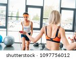 three multicultural sportswomen ... | Shutterstock . vector #1097756012
