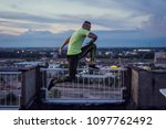 young handsome man jumping high ... | Shutterstock . vector #1097762492