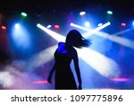 dancing silhouette of girl in a ... | Shutterstock . vector #1097775896