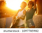 two young female friends... | Shutterstock . vector #1097785982