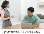 asian couple at home using a... | Shutterstock . vector #1097812232