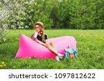 summer lifestyle portrait of...   Shutterstock . vector #1097812622