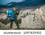 tourists climb to the top of... | Shutterstock . vector #1097829302