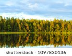 quiet evening on the lake in... | Shutterstock . vector #1097830136
