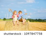 two little kid boys  twins and... | Shutterstock . vector #1097847758